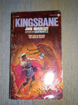 A paperback book cover depicting a warrior raising a knife at a cloaked figure.