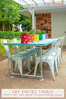Old Door Patio Table | Make a fun table with plumbing conduit and an old door! Complete photo tutorial.