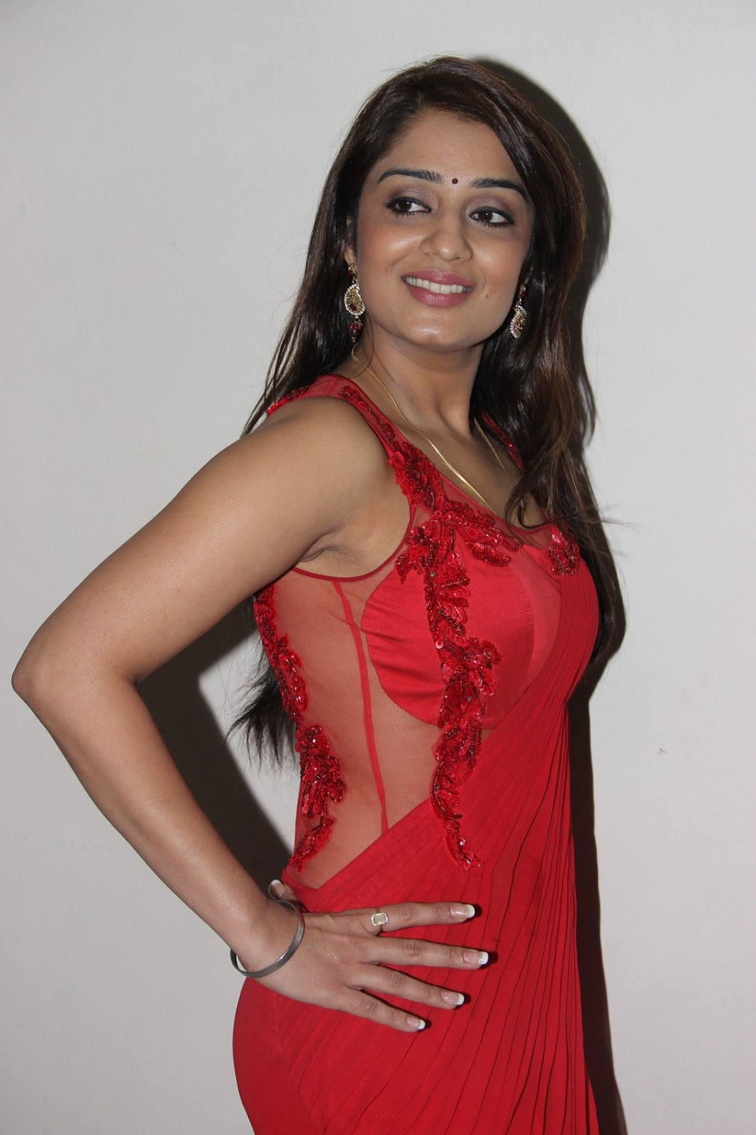 Nikita Thukral Hot Photoshoot In Red Saree