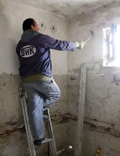 Bekir removing the old plaster