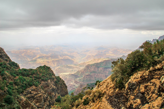 view of the surrounding canyons and mountains from our hike in the simien mountains on a foggy day