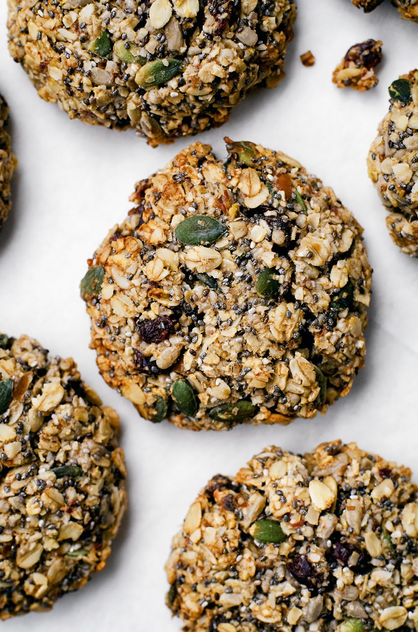 Vegan and gluten free oatmeal cookies totally packed with seeds and whole grain oats for an ultra healthy, delicious breakfast cookie. Made with a rich base of sunflower seeds, these are nut and sugar free and very high in protein.