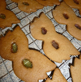 Picture of Christmas biscuits in super hero mask shapes with coloured eye holes from the boiled sweets