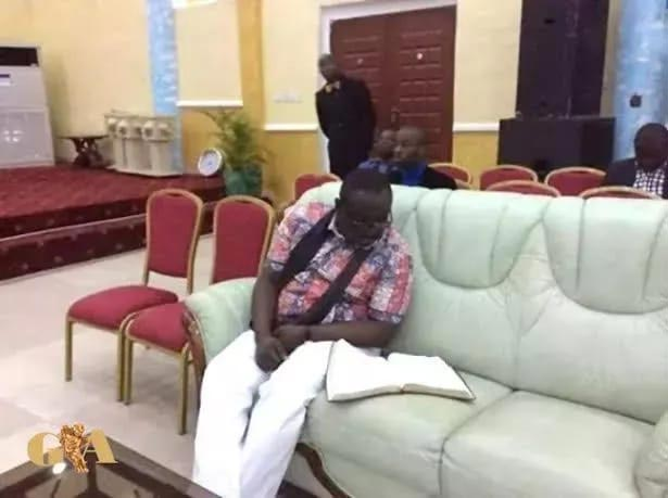 Governor Rochas Okorocha spotted studying his Bible in church
