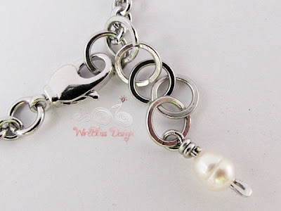 Close up of wire wrapped pearl charm and clasp for minima bracelet (Minlet) with pearl - Wisdom