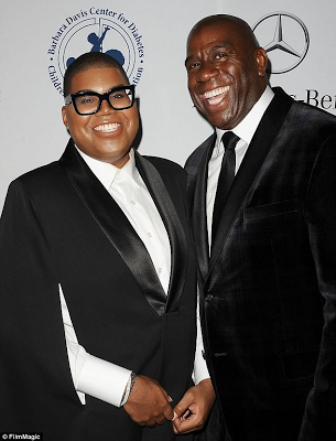 EJ Johnson shows off the diamond necklaces he received for Christmas