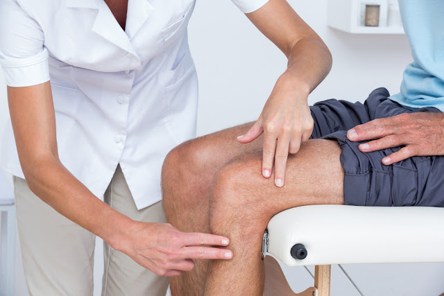 Image of a doctor using physical therapy to treat patient's sciatica.