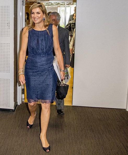 Queen Maxima wore MAJE jamais embroidered stretch jacquard knit skirt and Giuseppe Zanotti gold flats. Queen wore Natan dress