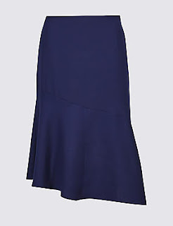 A navy or black skirt is a woman's office staple and this winter it will be asymmetrical