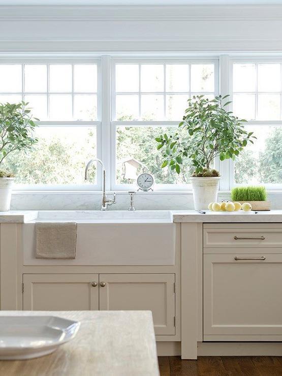 Tan Kitchen Cabinets. Christine Elliot Designs via Decorpad Cottage and Vine  Tan Kitchen Cabinets