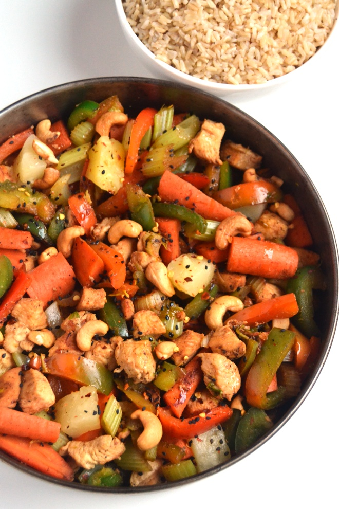 Easy Cashew Chicken is ready in just 15 minutes and is the perfect lighter stir-fry with chicken, cashews, peppers, carrots, pineapple, celery and a delicious homemade sauce! www.nutritionistreviews.com