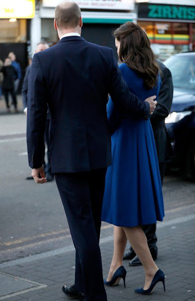 Kate Middleton wore Eponine London Belted Coat, Russell and Bromley Clutch, Gianvito Rossi Suade pumps