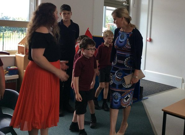 The Countess of Wessex wore a Body Con Reptile Moth Print Jersey Dress by Alexander Mcqueen while visiting the Mendip School and Gianvito Rossi pumps