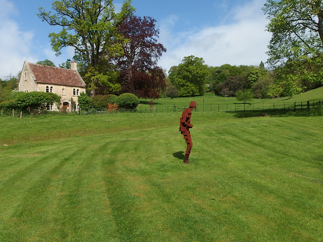 Picturesque cottage and Anthony Gormley sculpture