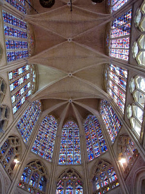 Looking up at the stained glass windows of Tours Cathedral