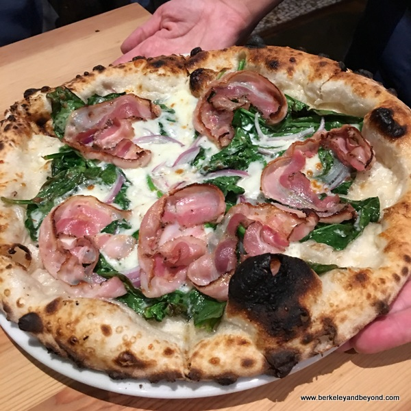 spinach-pancetta pizza at Benchmark Oakland in California