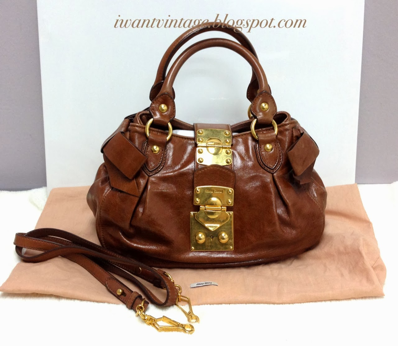 29139ea2e792 Miu Miu Vitello Lux Small Bow Bag with Clasp Lock Closure-Brown