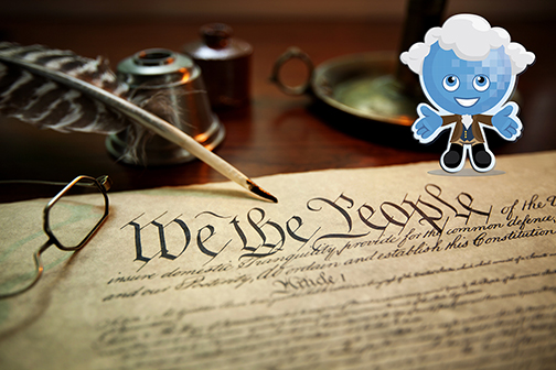 Image of the Constitution near a pair of old glasses, a quill and Rio mascot Splash dressed in founding father fashion and powdered wig.