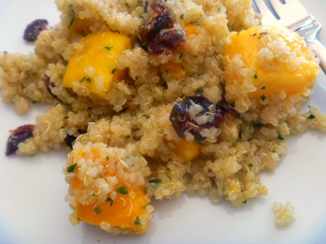 Quinoa Mango Salad:  This salad is filled with healthy goodness such as quinoa, mangoes and cranberries and doused with a light white wine vinaigrette that brings it all together. - Slice of Southern