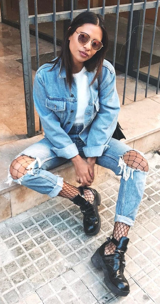 double denim fahion trends: jacket + destressed jeans + top + boots