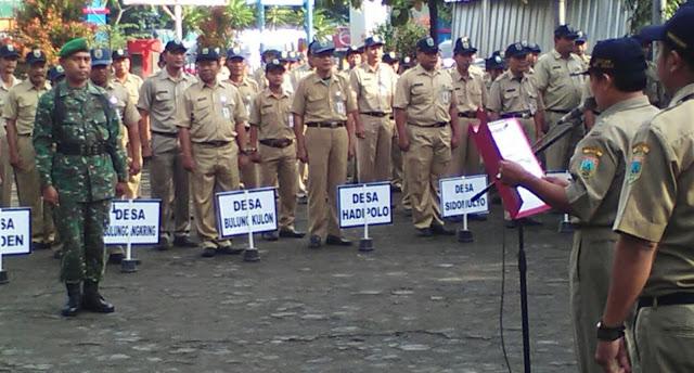 Babinsa Jabat Komandan Upacara Bendera Di Kecamatan Jekulo