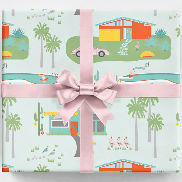 retro Palm Springs wrapping paper on square package with pink ribbon and bow