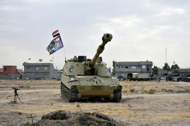 Iraq forces retake positions from Kurdish peshmerga fighters in disputed Kirkuk