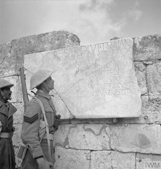 Indian soldier reading an ancient inscription in Cyrene, North Africa, 27 December 1941 (worldwartwo.filminspector.com