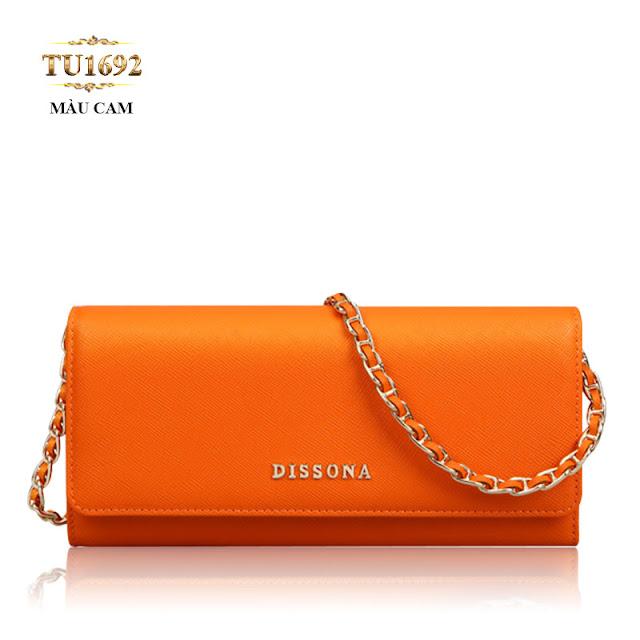 Xuống phố với chiếc Clutch Dissona dây xích màu cam thời trang TU1692