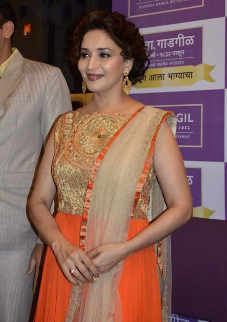 Madhuri Dixit in Orange Anarkali Suit At Gadgil Jewellers