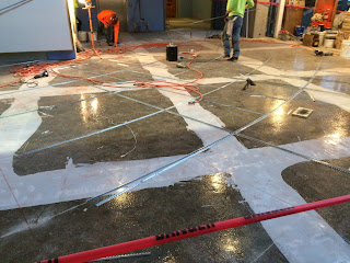 Floor being constructed with metal bars crossing it.