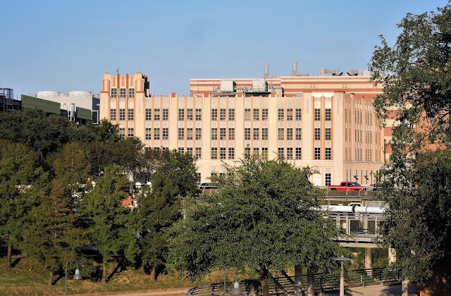 Historic Peden Co. Building seen across Buffalo Bayou at Allens Landing