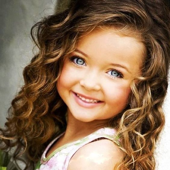 Cute Baby Girl with Blue Eyes and Curly Hair
