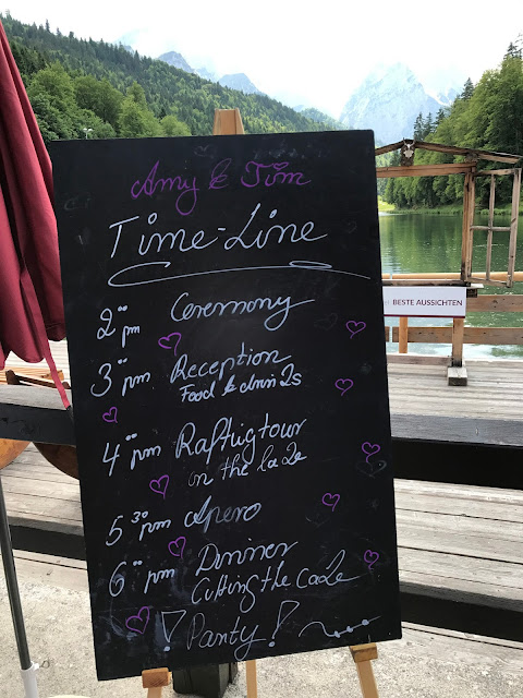 Time Line chalk board,  shades of raspberry and apricot, lake-side wedding in the Bavarian mountains, Garmisch-Partenkirchen, Germany, wedding venue Riessersee Hotel, wedding planner Uschi Glas, getting married abroad