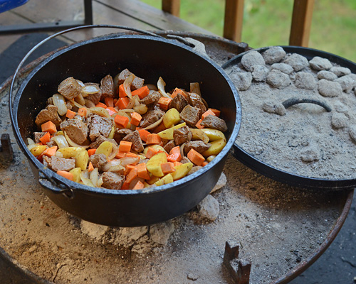 Maafe cooked on an open fire pit