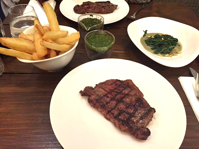 steak with chips and creamy spinach