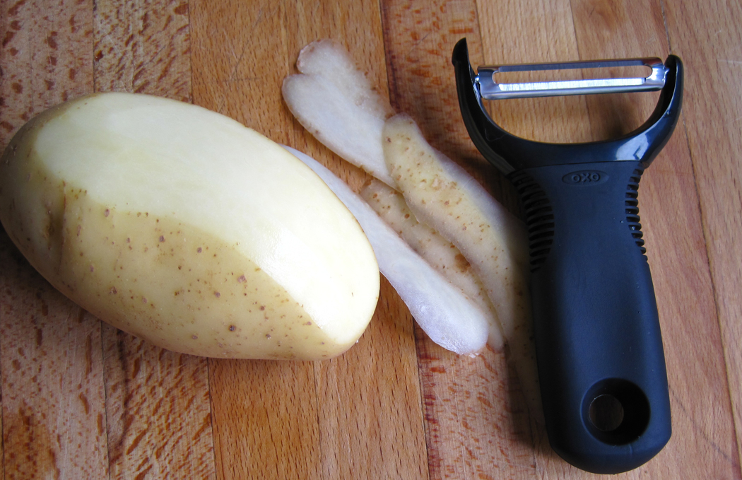 OXO Good Grips Y Peeler and a potato
