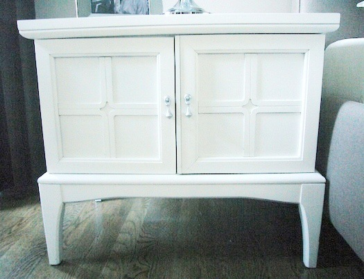 After-the Danish nightstand was painted bright white