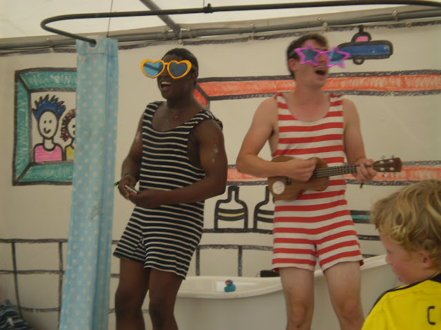 men in bathing costumes singing