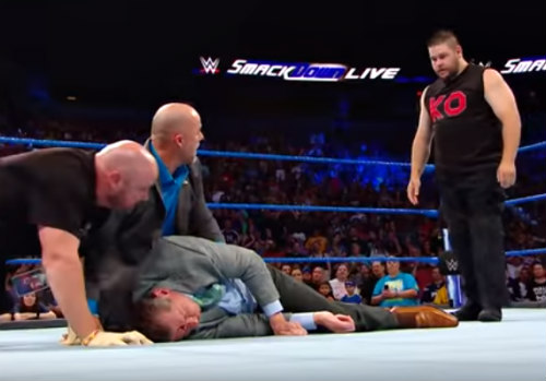 Kevin Owens Looks At An Injured Vince McMahon