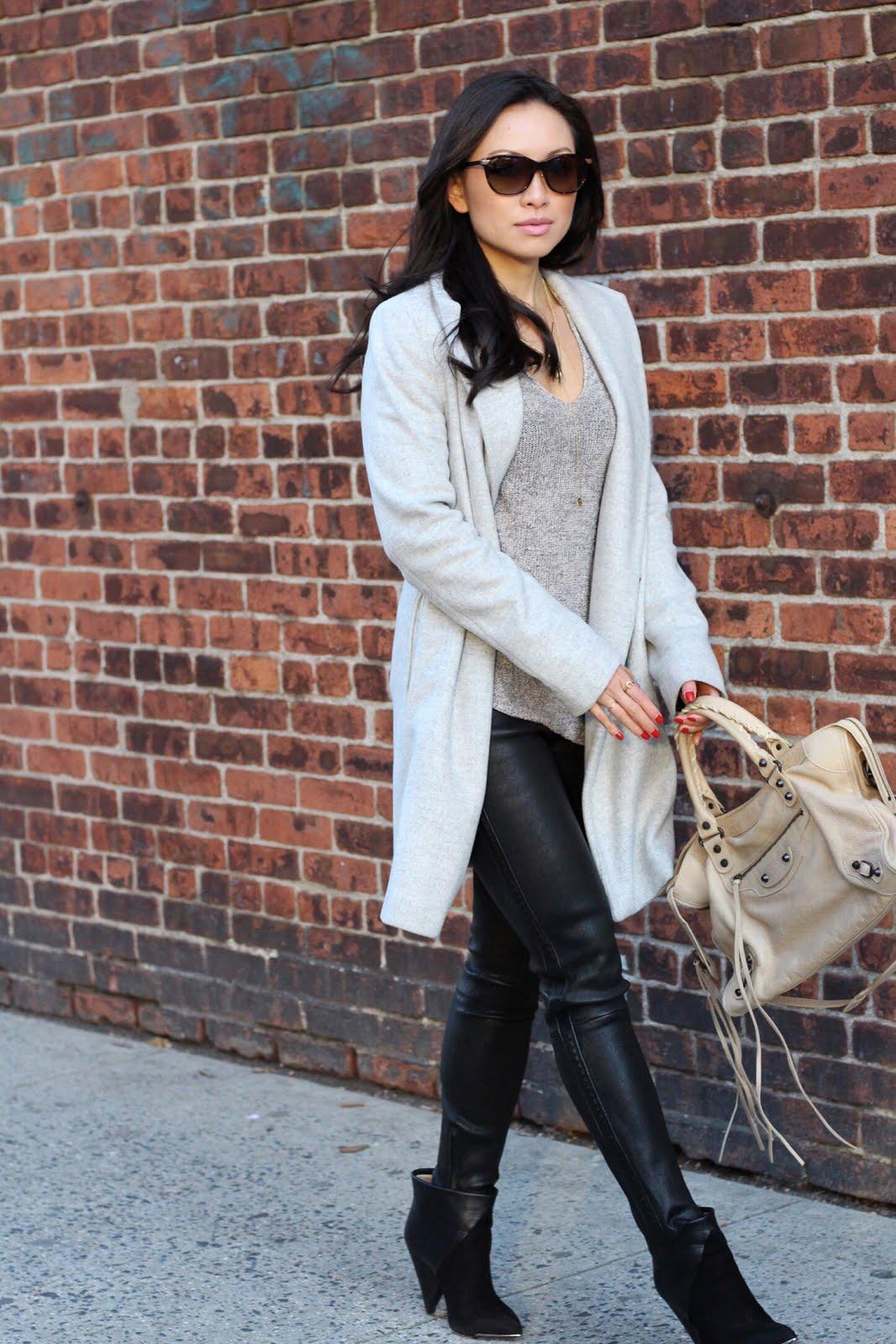 Zara knit sweater J Brand leather pants IRO Keira booties Balenciaga sahara city bag