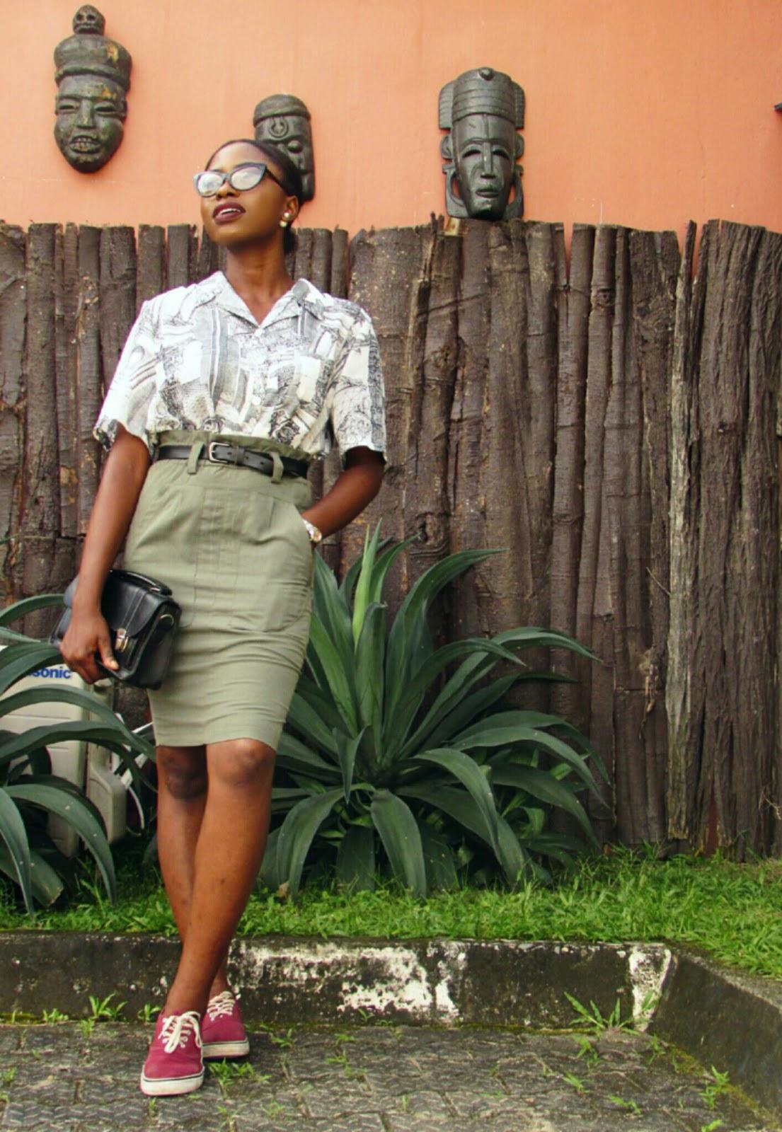 Burgundy sneakers, cateye frames, vintage shirt