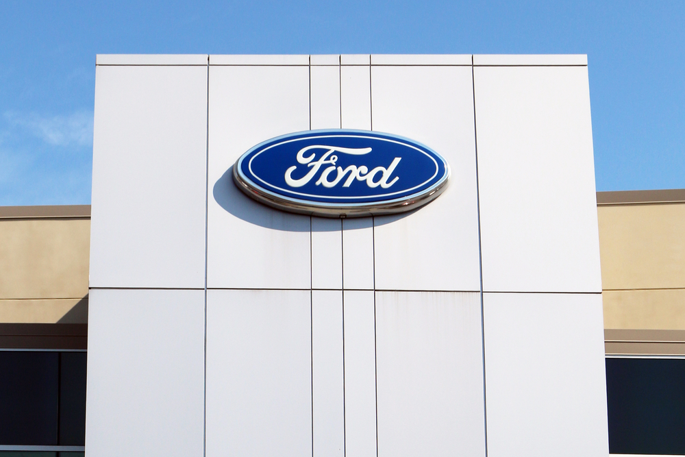 Ford Logo  on a White Wall Outside a Building