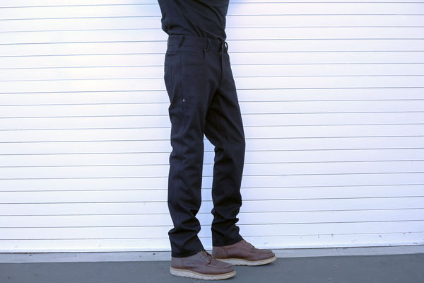 Side view of a rider wearing the Rev'it Orlando H2O denim jeans