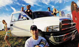 image in color of Matt Billmeier's 1995 Dodge Ram truck with him and a lot of people around