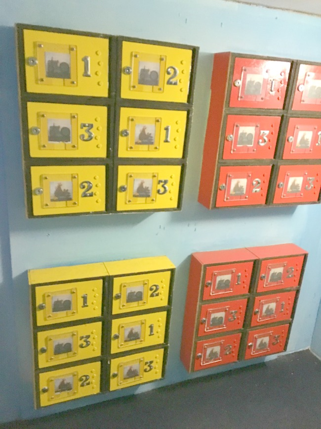red-and-yellow-boxes-with-numbers-and-pictures-at--Perrygrove-Railway-Indoor-Village