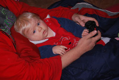 Gamer baby helps Daddy play video games