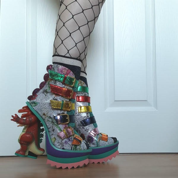 side view of colourful rubber platform boots with dinosaur heel and floral patent uppers
