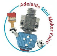The coloured badge given to all attendees featuring the Adelaide Mini Maker Faire Logo