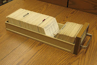 A drawer from a card catalog, with cards